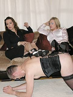 Femdom ladies are enjoying the cock-caged sissy dress-up process and then give him harsh OTK spanking