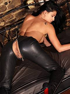 Femdom teaser is wearing tight leather pants and having a load of cum spread all over her sexy ass