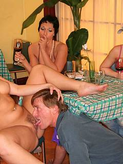 Hubby is on his knees and licking wife's pussy in public place: in the cafeteria, in front of her mates