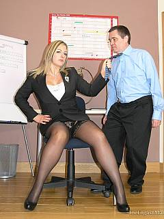 Dude is educated by a couple of sexy office bitches: humiliated verbally, spanked OTK and caned nicely