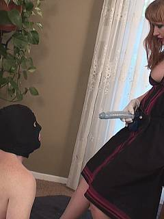 Demanding redhead is approaching bald slave with the strap-on cock planning to penetrate each of his holes