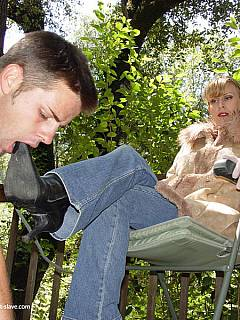 Petboy is dragged outdoors on a rope leash where he has to lick mistress feet and suck her toes
