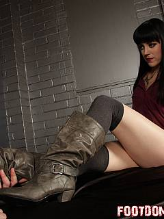 Dominatrix comes to the BDSM dungeon to have her leather boots polished by femdom slave