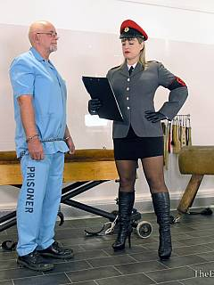 Severe canning in prison: Goddess in military uniform is having older bald male bent forward and interrogated