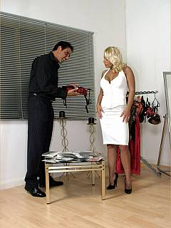 Dominatrix is making the slave happy by providing him with lingerie and pantyhose he can sniff