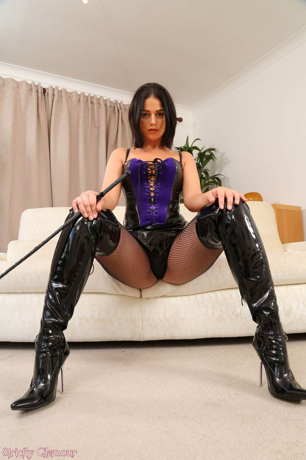 Picture #4 of Amateur dominant girl is having a while range of sexy clothing to punish men in: high heel boots, PVC skirt abd sexy fishnets