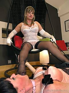 Trained sissy is dressed up as maid and having a pleasure of sucking dominatrix toes
