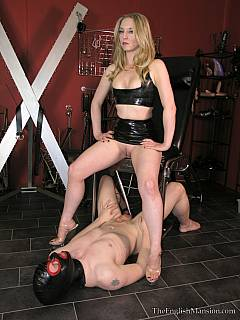 Mistress is just peed all over the willing slave and it is time for him to lick her pussy clean