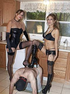 MILF mother and her daighter are black lingerie are posing for trampling session with femdom slave swallowing their spits