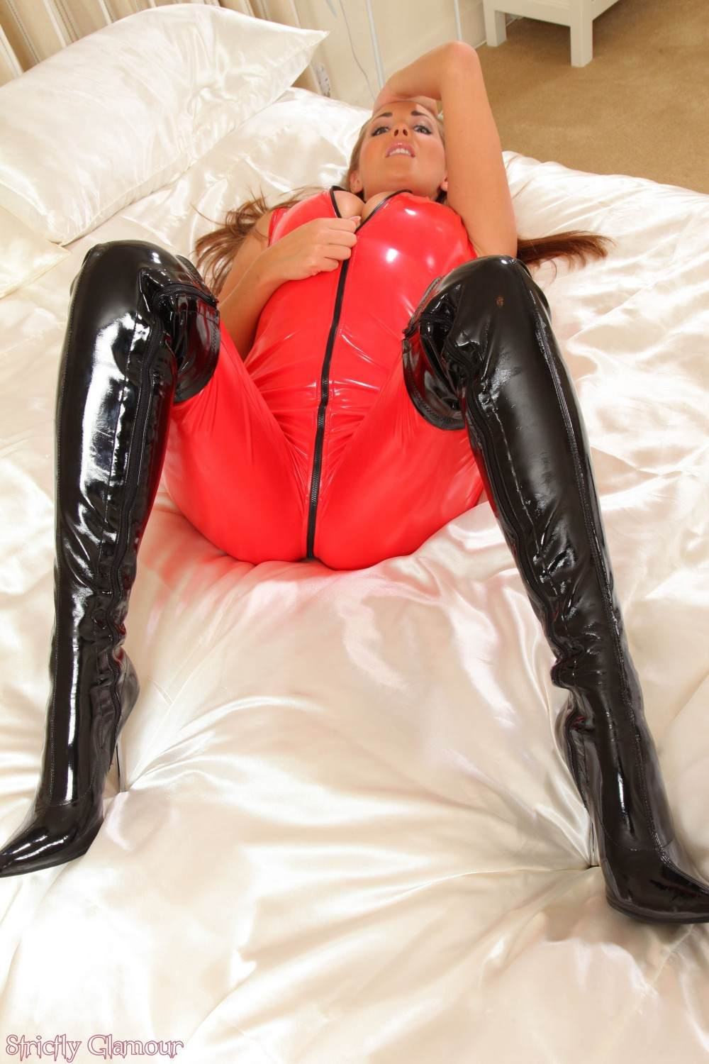 Picture #3 of How do you feel about getting whipped by a sexy blond in PVC catsuit and knee boots?