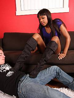 Interracial couple of having fun: black girlfriend is trampling her man in leather boots