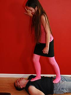 Sweet trampling scene where barefoot girl is walking a man in pink fishnets