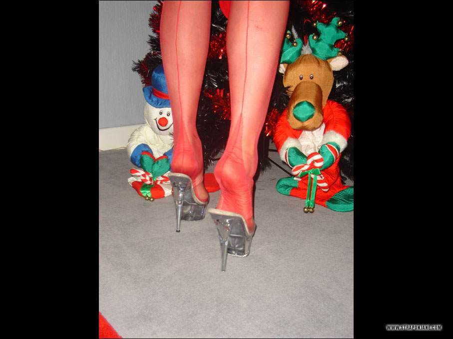 Picture #2 of Leggy mistress is looking for kinky presents under the new year tree