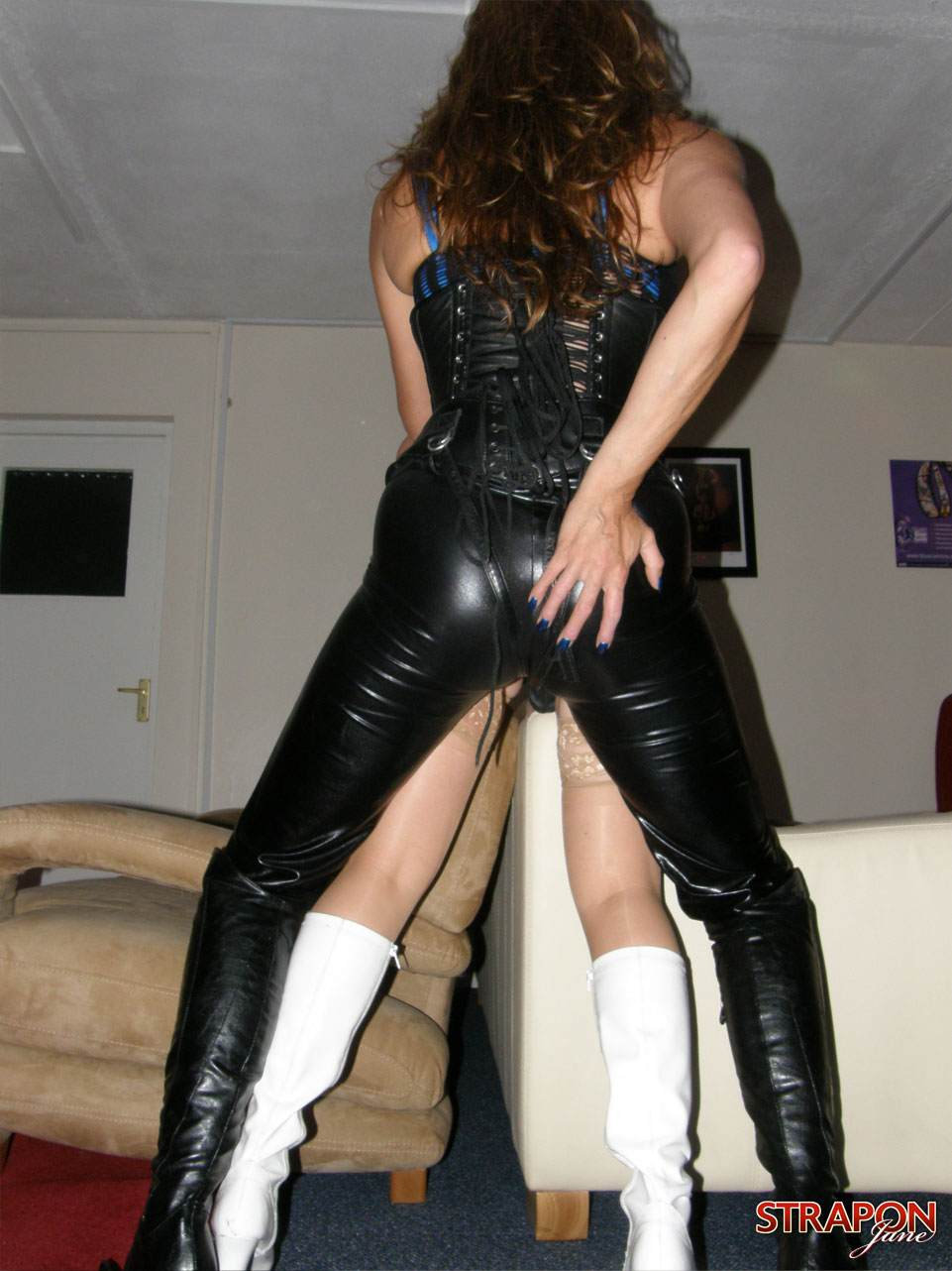 Picture #8 of Blond plumper got rubber cock in her ass and pussy when bent over the sofa by dominant bitch