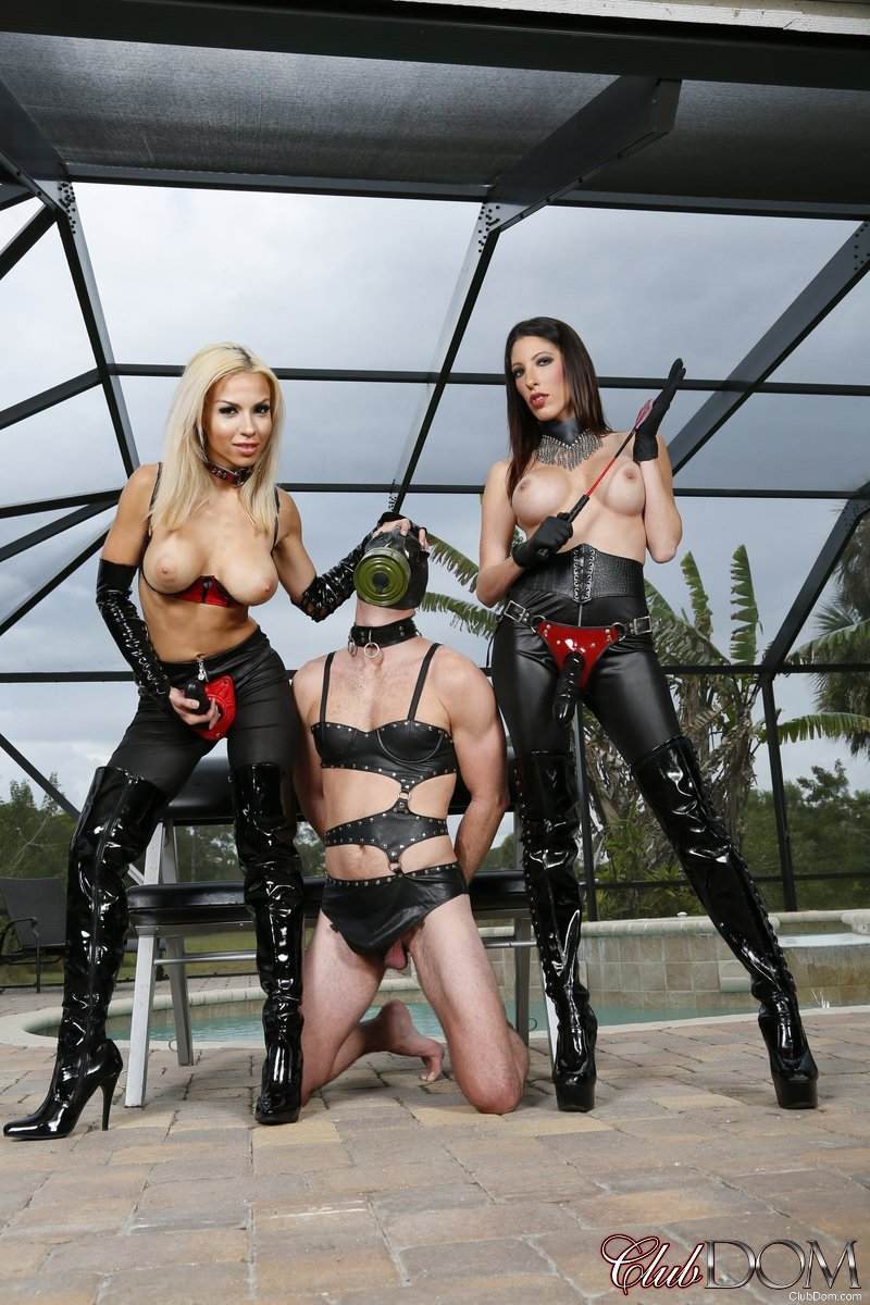 Picture #4 of Topless strap-on bitches in leather pants are posing beside the kneeling slave they are about to fuck big time