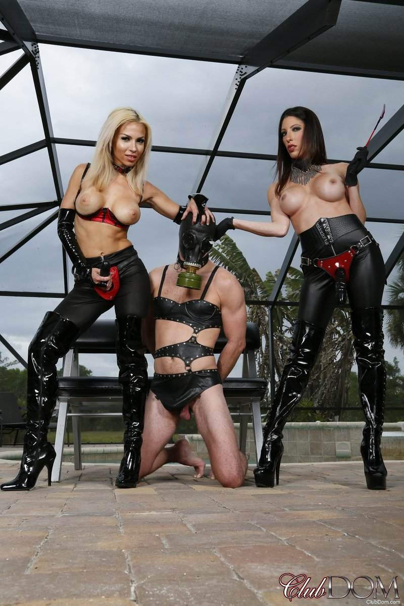 Picture #5 of Topless strap-on bitches in leather pants are posing beside the kneeling slave they are about to fuck big time