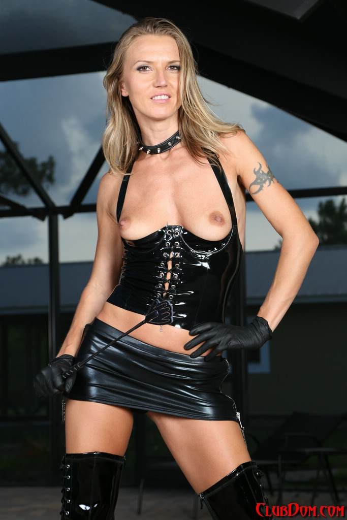 Picture #9 of Slim babe is all dressed up for femdom action: wearing PVC lingerie and a pair of knee-boots