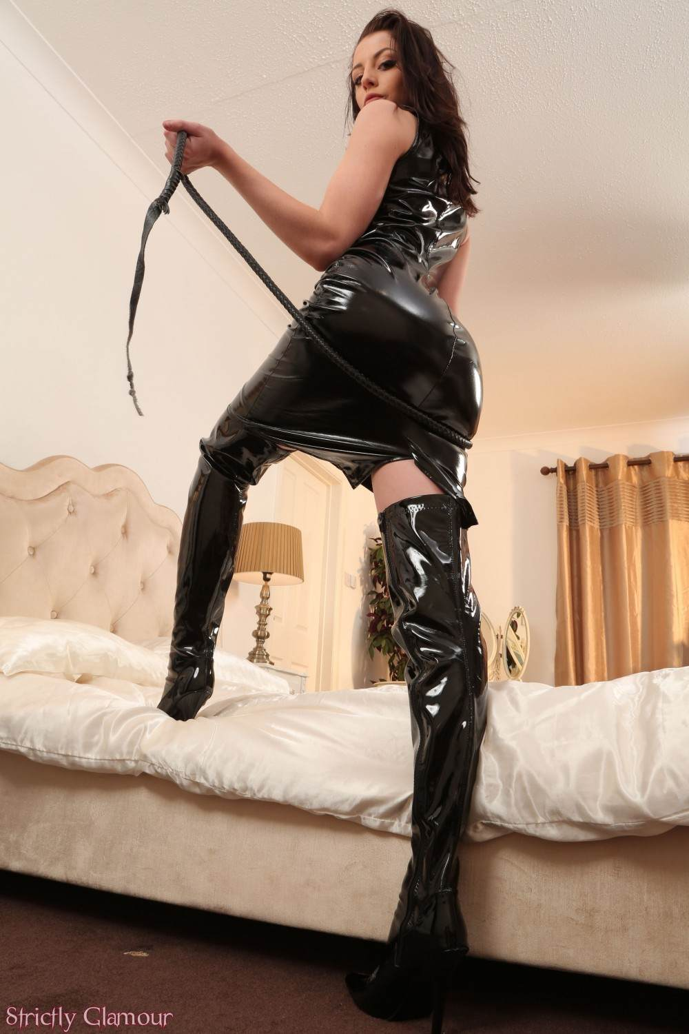 Picture #3 of Slim babe is going to do the femdom whipping in PVC dress and then strip down to her very knickers