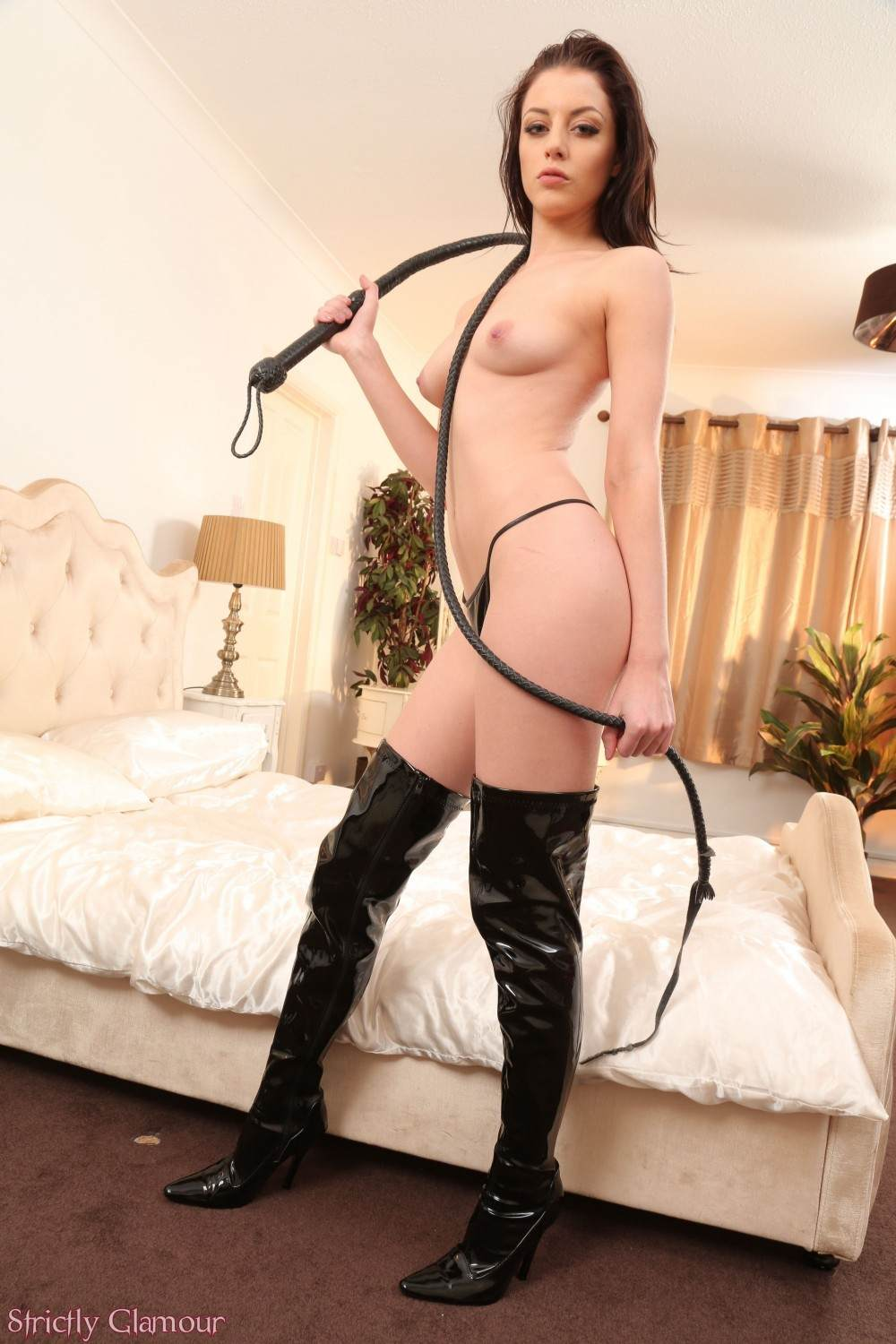 Picture #10 of Slim babe is going to do the femdom whipping in PVC dress and then strip down to her very knickers