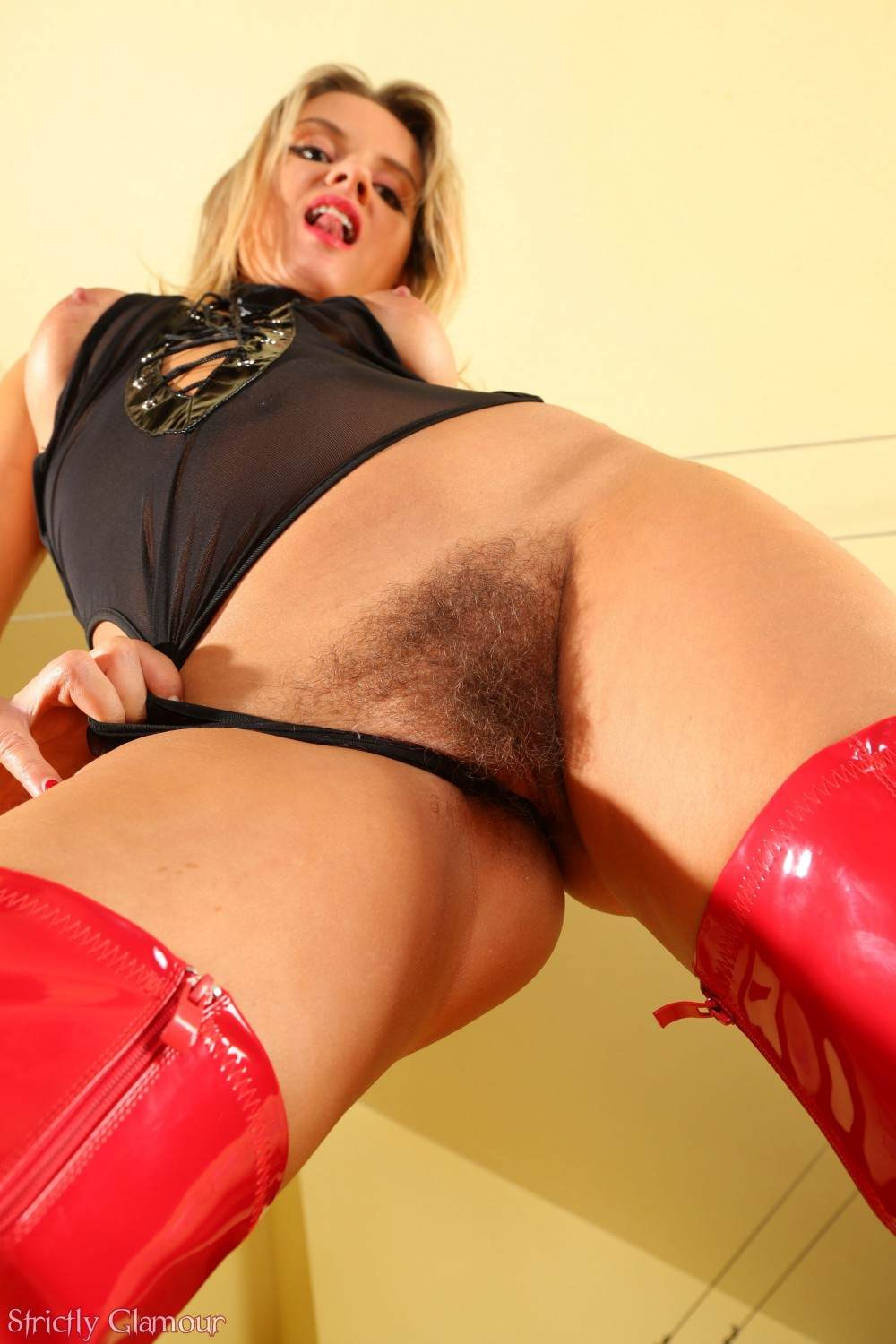 Picture #10 of Become submissive to obey the blond mistress and maybe she will let you sniff her hairy pussy afterwards