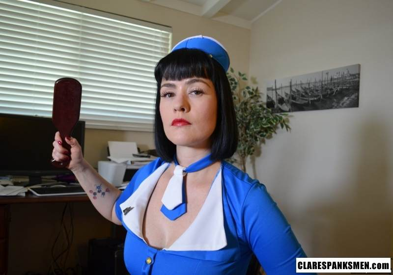 Picture #7 of Naughty spanking domme put on kinky air hostess uniform for this round of over the knee spanking