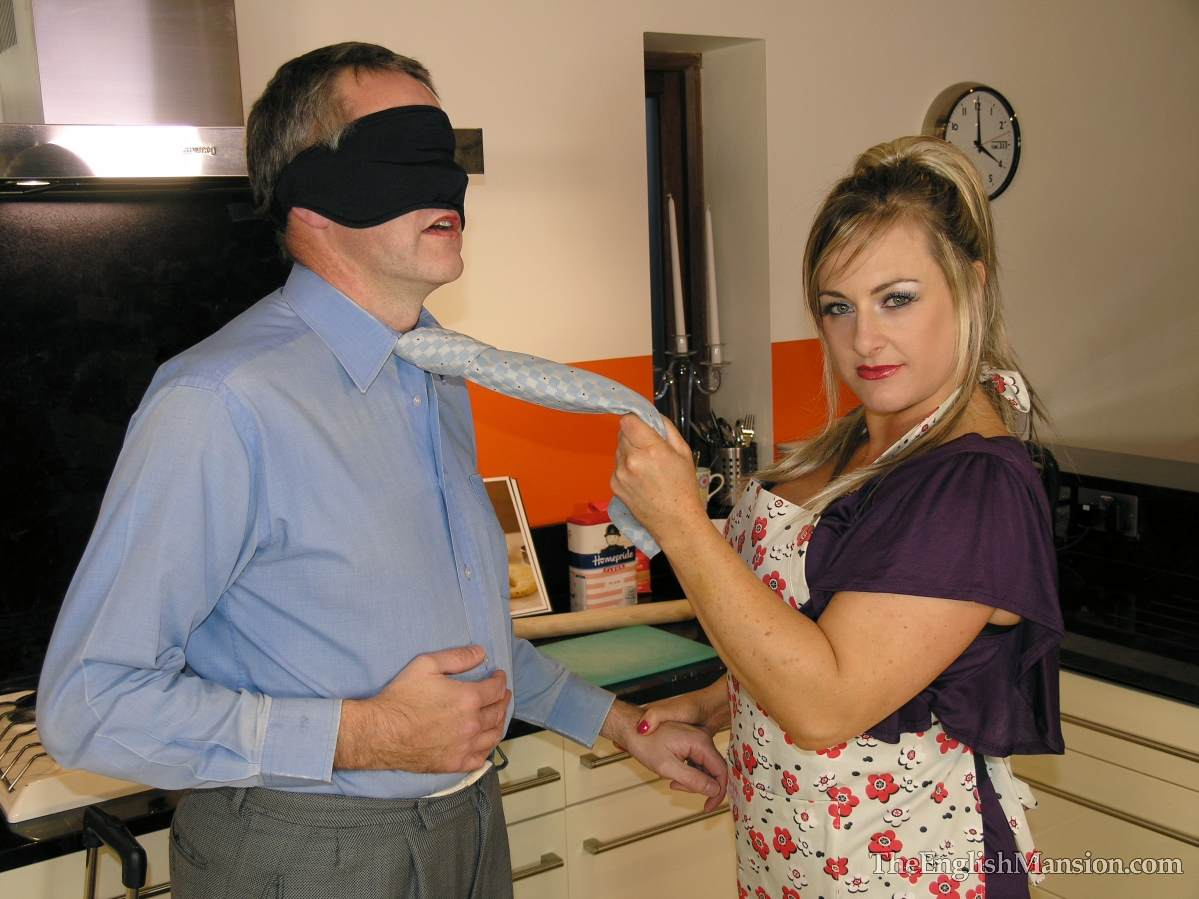 Picture #6 of Dominatrix is sharing her husband with a number of girlfriends: handcuffed, exposed and available for all kinds of cock tortures