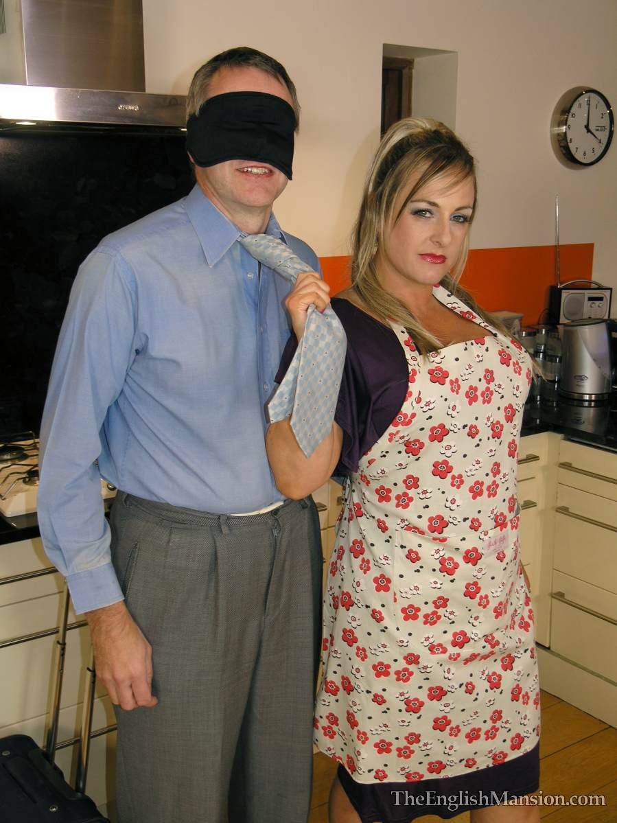 Picture #7 of Dominatrix is sharing her husband with a number of girlfriends: handcuffed, exposed and available for all kinds of cock tortures