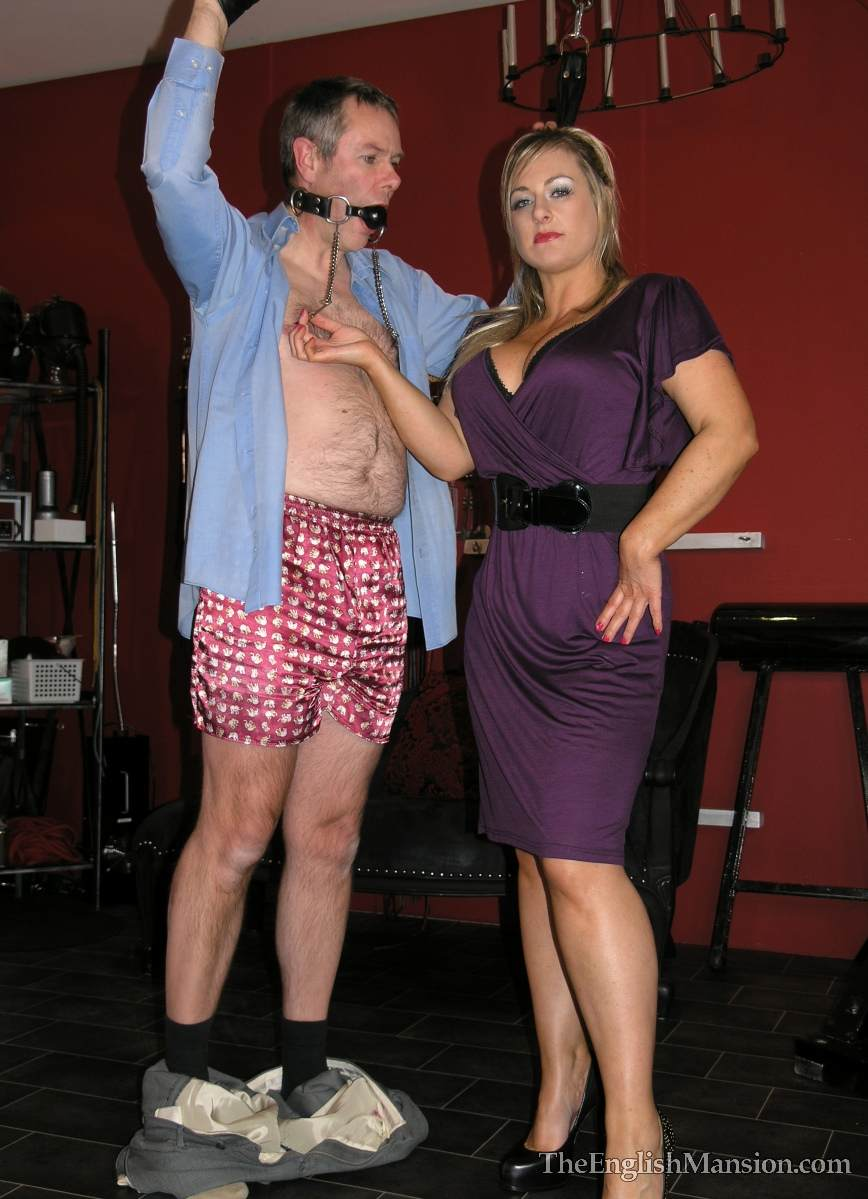 Picture #8 of Dominatrix is sharing her husband with a number of girlfriends: handcuffed, exposed and available for all kinds of cock tortures