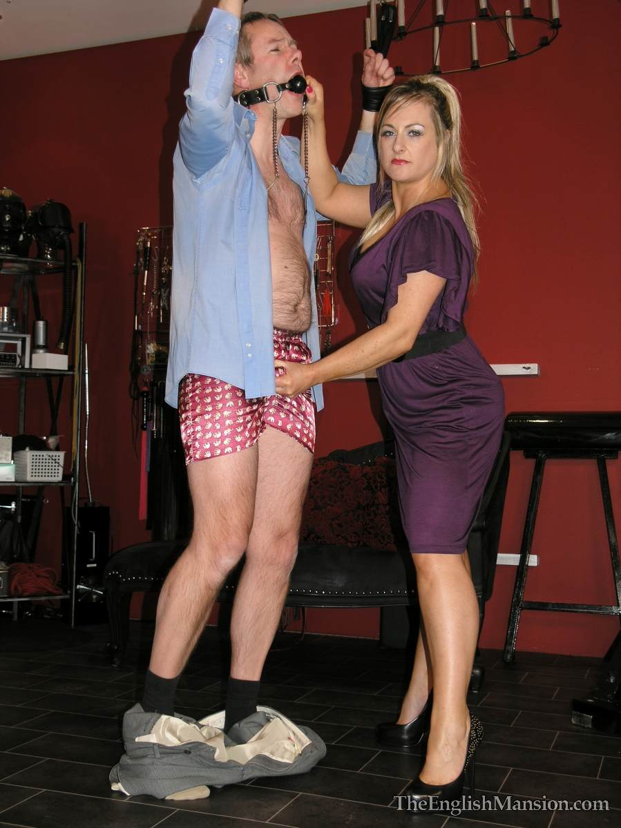 Picture #10 of Dominatrix is sharing her husband with a number of girlfriends: handcuffed, exposed and available for all kinds of cock tortures
