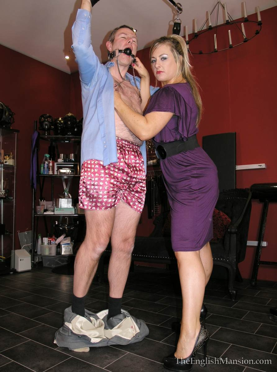 Picture #12 of Dominatrix is sharing her husband with a number of girlfriends: handcuffed, exposed and available for all kinds of cock tortures