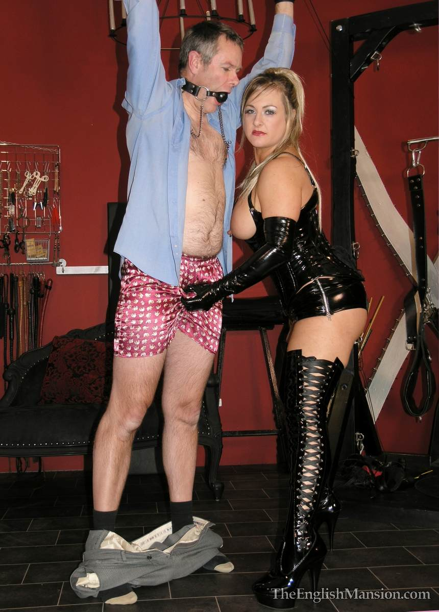 Picture #13 of Dominatrix is sharing her husband with a number of girlfriends: handcuffed, exposed and available for all kinds of cock tortures