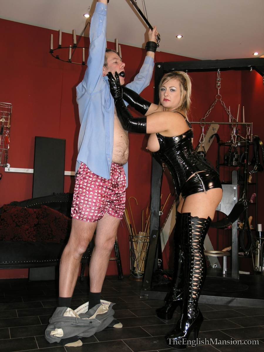 Picture #14 of Dominatrix is sharing her husband with a number of girlfriends: handcuffed, exposed and available for all kinds of cock tortures