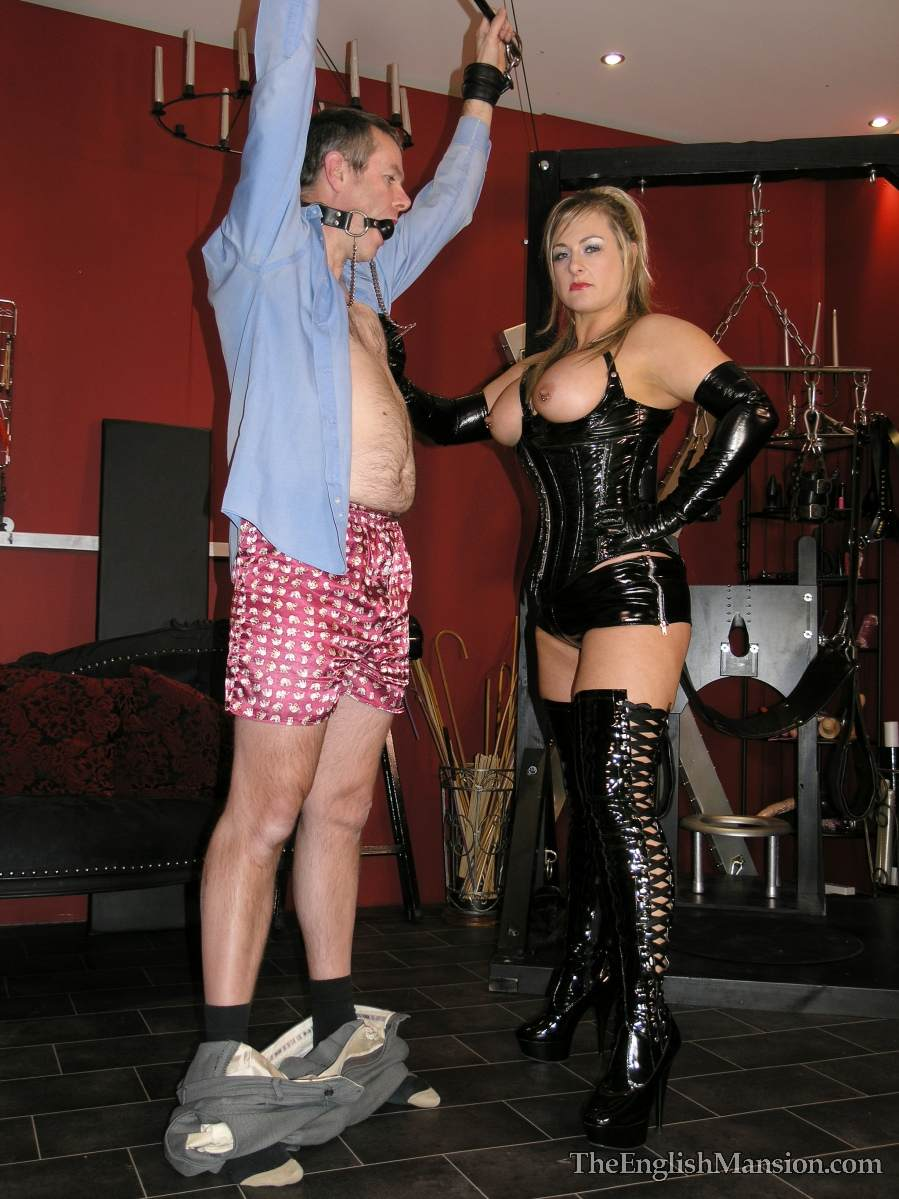 Picture #15 of Dominatrix is sharing her husband with a number of girlfriends: handcuffed, exposed and available for all kinds of cock tortures