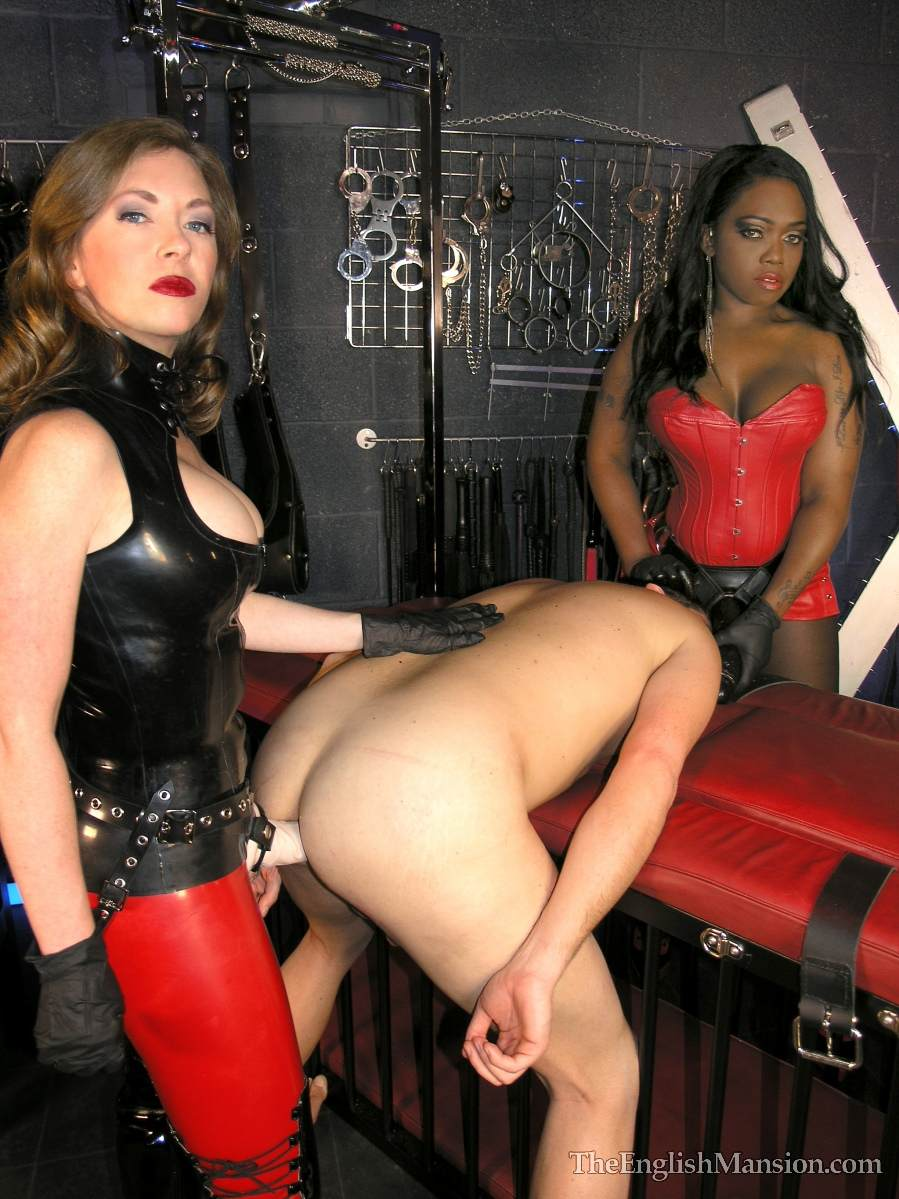 Picture #6 of A team of black and white girls are in the BDSM chamber: turning slave into anal sissy with a pair of really big strap-on toys