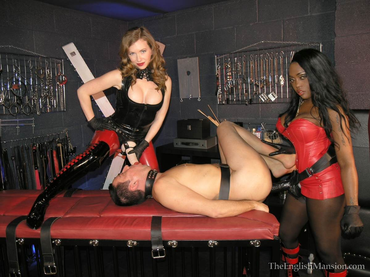 Picture #9 of A team of black and white girls are in the BDSM chamber: turning slave into anal sissy with a pair of really big strap-on toys