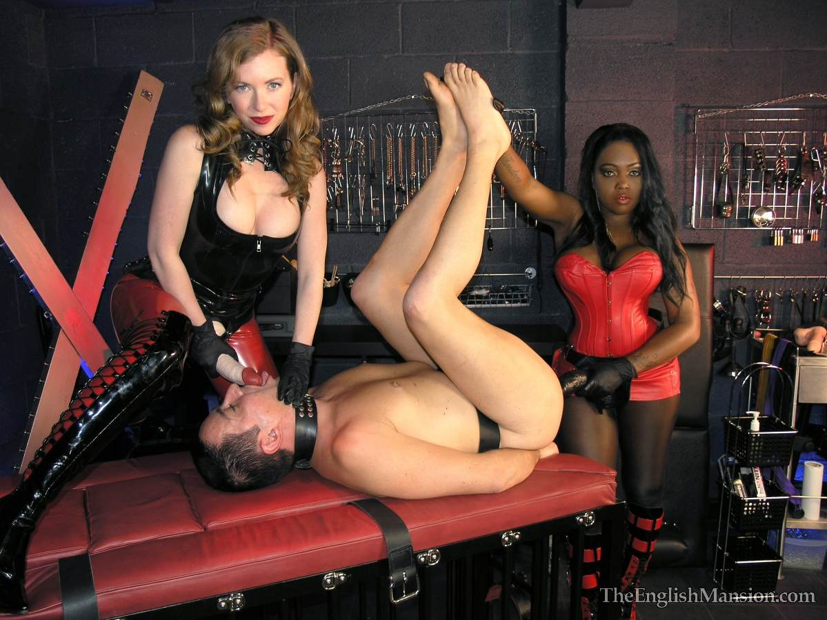 Picture #12 of A team of black and white girls are in the BDSM chamber: turning slave into anal sissy with a pair of really big strap-on toys