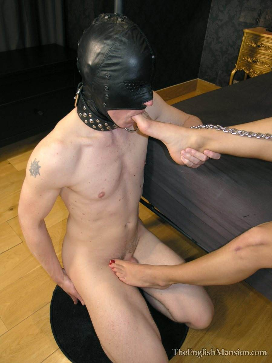 Picture #4 of Erotic mistress is having her bare feet sucked by masked and begged for a foot job