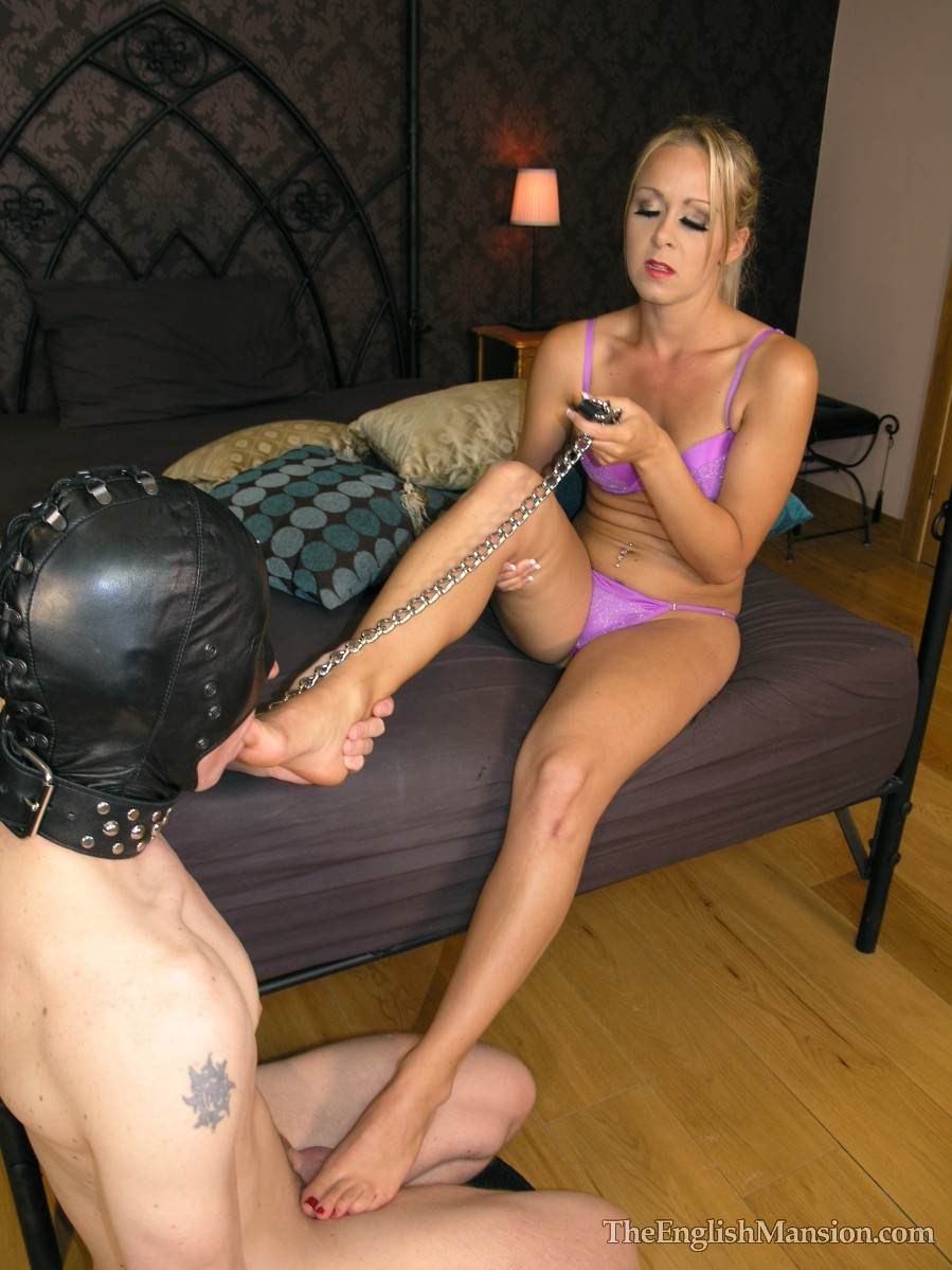 Picture #5 of Erotic mistress is having her bare feet sucked by masked and begged for a foot job