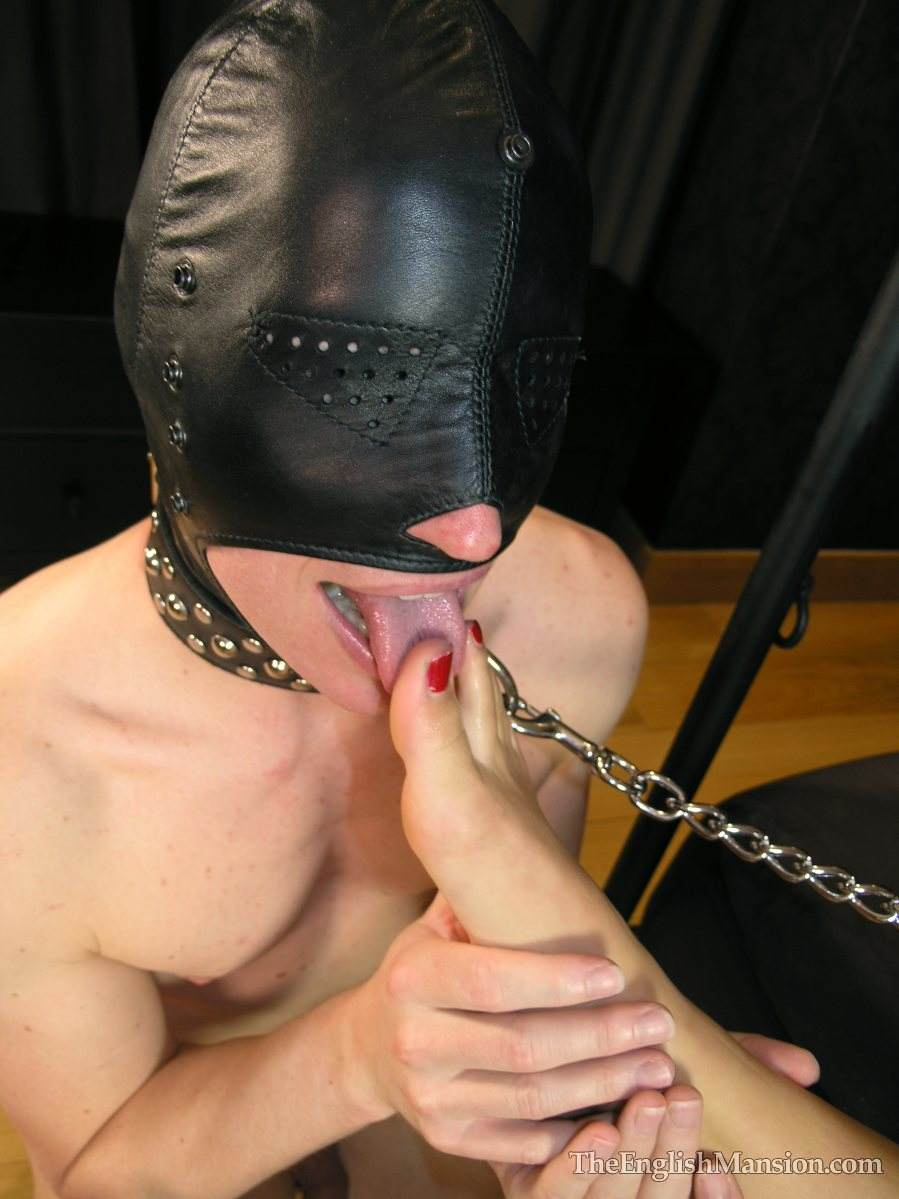 Picture #10 of Erotic mistress is having her bare feet sucked by masked and begged for a foot job