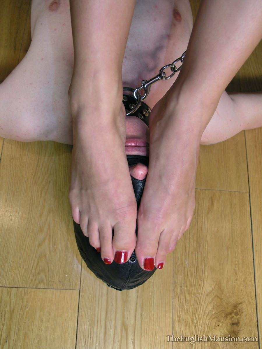Picture #17 of Erotic mistress is having her bare feet sucked by masked and begged for a foot job