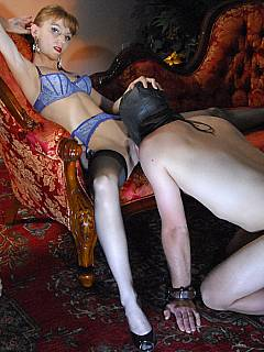 Femdom slave is allowed to put his face in between those heavenly sexy legs and lit the cunt clean