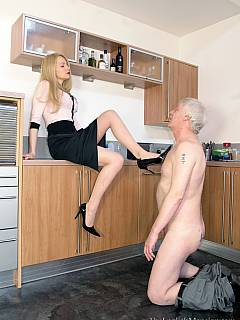 Tall blond is making old pervert happy by pulling his pants and paddling his ass