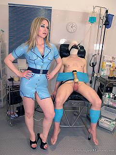 Cruel nurse is in the middle of kinky femdom action where slave is tied to medical chair and milked with bizarre device