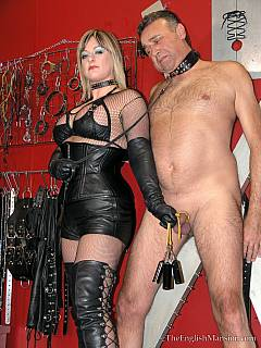 Cruel MILF dragged a slave into her BDSM chamber: she is free to do whatever she wants to the collared male