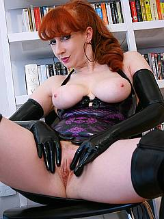 MILF is wearing sexy black rubber: spreading legs and touching herself in between in gloves