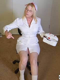 Bitchy MILF nurse wants you to lower your pants and lay down over her knee to get a shot and nice hand spanking