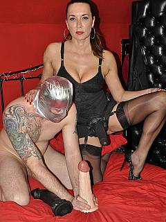 Anal femdom slave is lubricating a couple of monster dildo toys with his own saliva expecting beautiful woman to fuck him with