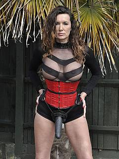 Leggy Goddess is up for an outdoor stroll in a very kinky fetish outfit and with a big black strap-on sex toy attached