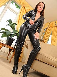 Hot babe in black leather catsuit is handling single-tail whip like a pro
