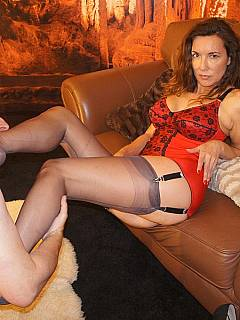 Old pervers is having great time worshiping the nyloned feet mistress is gagging his mouth with